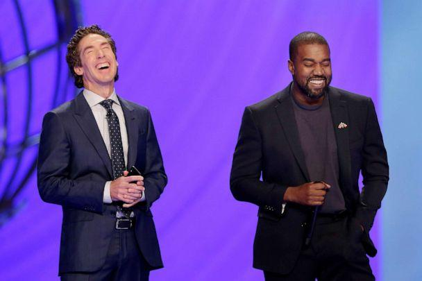 PHOTO: With their eyes closed for prayer, Joel Osteen, left, and Kanye West laugh as West makes a joke while leading the prayer during a service at Lakewood Church, Nov. 17, 2019, in Houston. (Michael Wyke/AP)