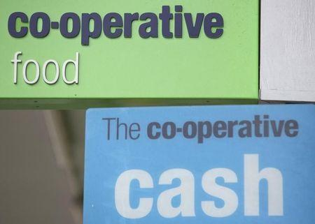Signs are displayed outside of a branch of a Co-operative food store in north London April 17, 2014. REUTERS/Neil Hall