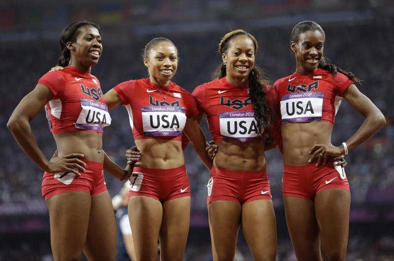 United States' women's 4 X 400-meter relay team from left, Francena McCorory, Allyson Felix, Sanya Richards-Ross and Deedee Trotter celebrate after winning the gold medal during the athletics in the Olympic Stadium at the 2012 Summer Olympics, London, Saturday, Aug. 11, 2012.  (AP Photo/Anja Niedringhaus)
