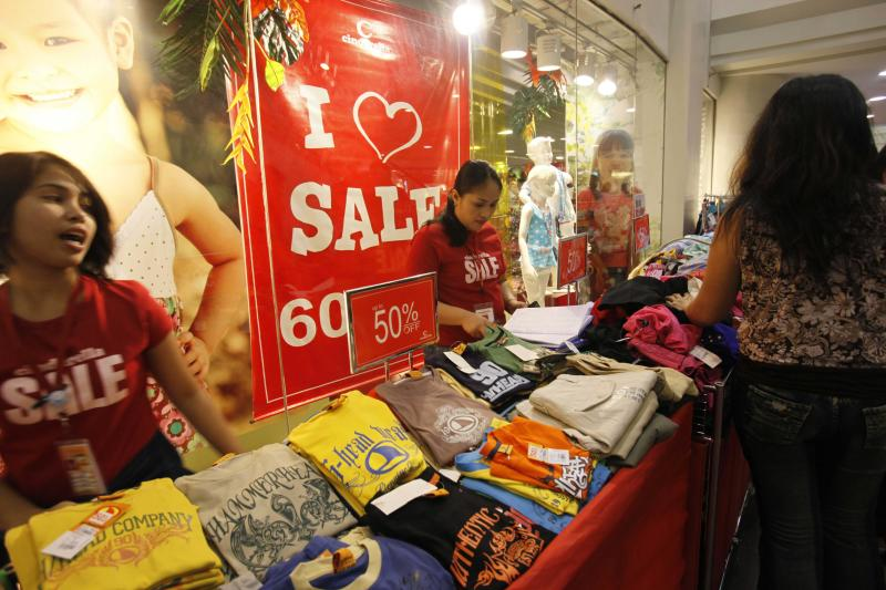 File Photo: In this Sunday March 21, 2010 photo, vendors display items on sale at Robinson's Place, a huge shopping mall in Manila, Philippines. (AP Photo/Bullit Marquez)