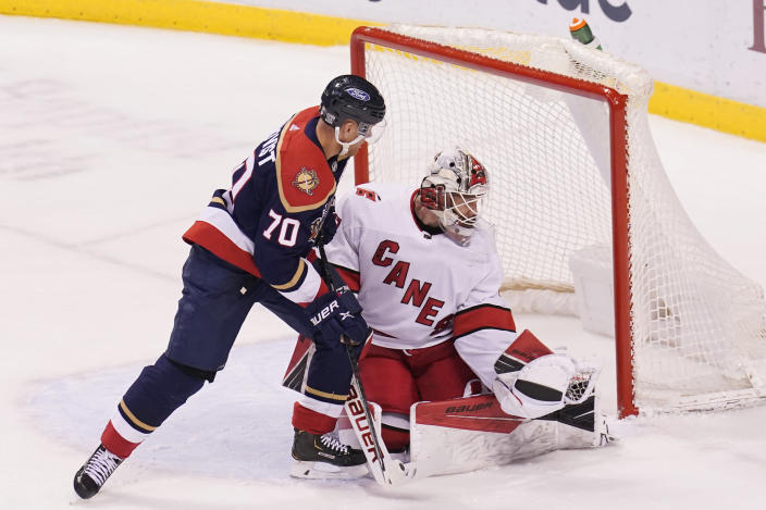 Carolina Hurricanes goaltender James Reimer (47) grabs the puck from a shot by Florida Panthers right wing Patric Hornqvist (70) during the second period at an NHL hockey game, Saturday, Feb. 27, 2021, in Sunrise, Fla. (AP Photo/Marta Lavandier)