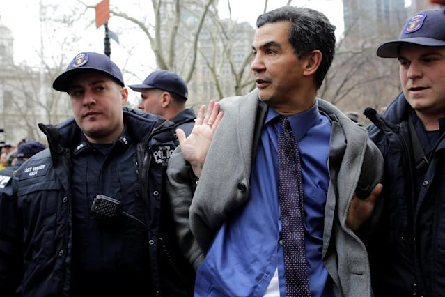 <p>New York City Council member Ydanis Rodriguez is detained by police during a demonstration by activists against deportation outside the Jacob Javits Federal Building in Manhattan in New York City, Jan. 11, 2018. (Photo: Eduardo Munoz/Reuters) </p>