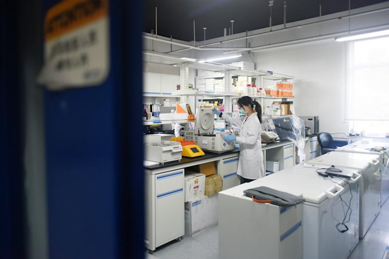 This picture taken on May 14, 2020 shows a researcher at Peking University's Beijing Advanced Innovation Center for Genomics conducting tests at their laboratory in Beijing. - The Chinese laboratory says it has developed a drug it believes has the power to bring the COVID-19 coronavirus pandemic to a halt, shortening the recovery time for those infected and even offering short-term immunity from the virus. (Photo by WANG ZHAO / AFP) / TO GO WITH Health-virus-China-vaccine,FOCUS by Qian Ye and Matthew Knight (Photo by WANG ZHAO/AFP via Getty Images)