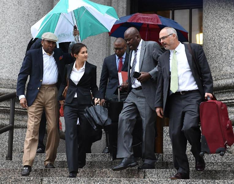 Attorneys Beatrice Lindstrom (2nd L) Marioa Joseph (2nd R), who presented the case against the UN over the cholera epidemic in Haiti, leave the federal courthouse in New York on October 23, 2014 (AFP Photo/Don Emmert)