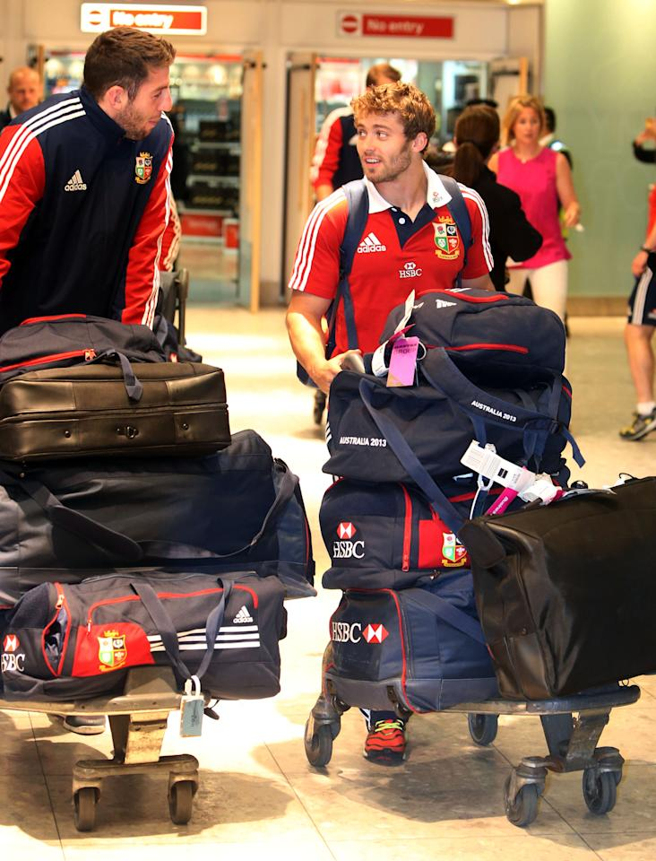 Alex Cuthbert (left) and Leigh Halfpenny of the British and Irish Lions, arrive at Heathrow Airport, following their Test series triumph against Australia, just hours before the England cricket team pick up the baton.