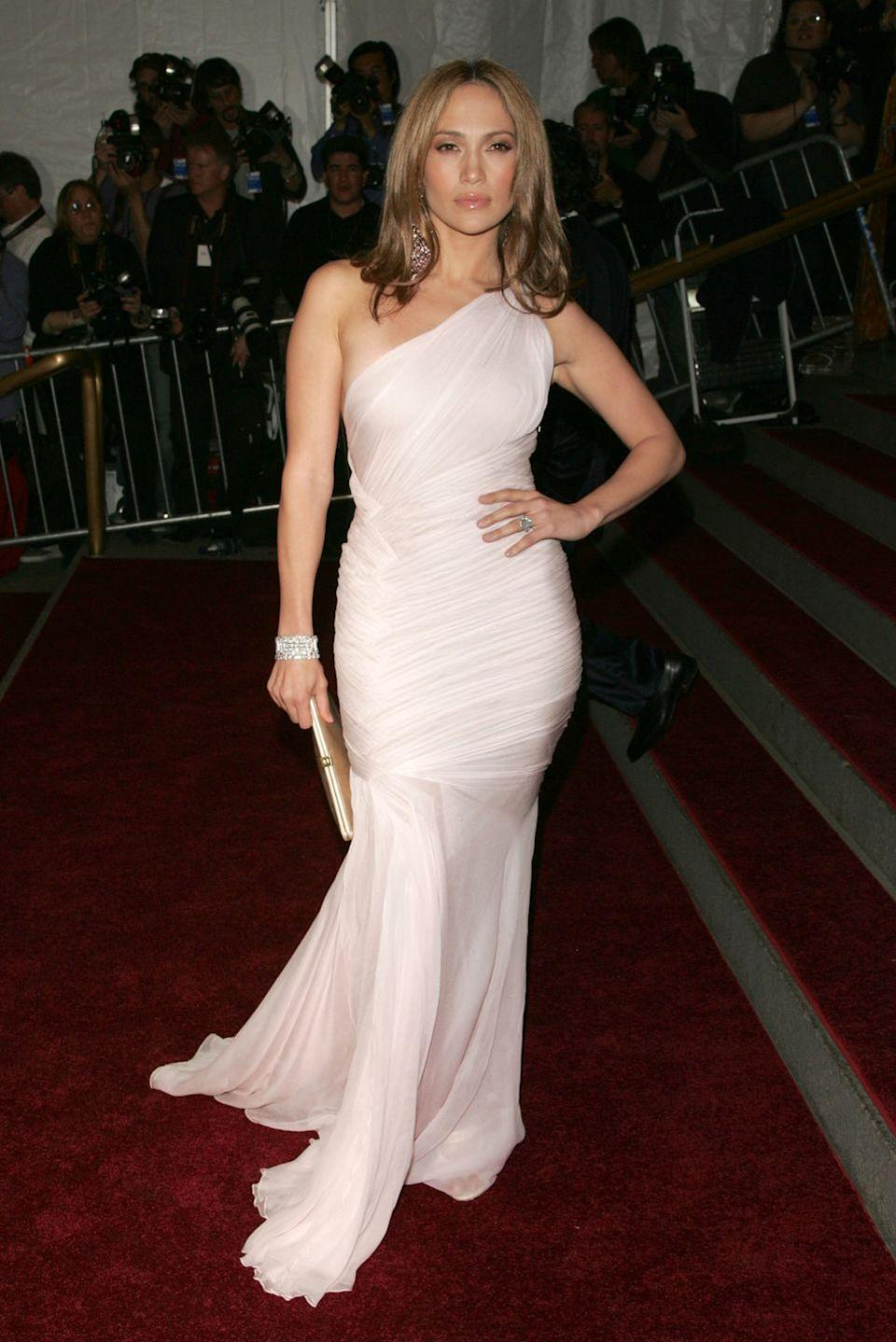 <p>She's looking angelic as ever in a pale pink one-shoulder dress at the Met Gala. It's a bit more simple than J.Lo's usual style, but damn the woman can really pull off anything.</p>