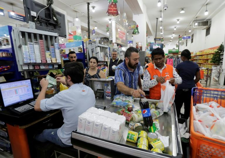The Lebanese Consumers Association said the dollar shortage is causing higher food prices (AFP Photo/ANWAR AMRO)