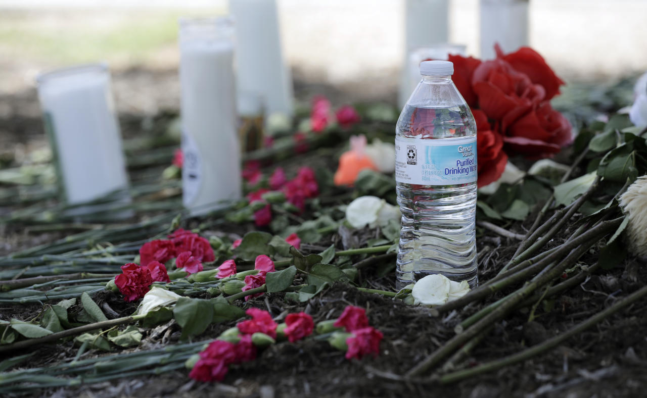 <p> A bottle of water, flowers, candles, and stuffed animals help form a makeshift memorial in the parking lot of a Walmart store near the site where authorities Sunday discovered a tractor-trailer packed with immigrants outside a Walmart in San Antonio, Monday, July 24, 2017. Several people died and others hospitalized after being crammed into a sweltering tractor-trailer in the midsummer Texas heat, according to authorities in what they described as an immigrant-smuggling attempt gone wrong. (AP Photo/Eric Gay) </p>