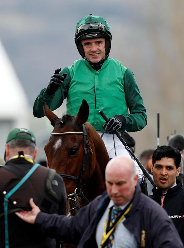 Horse Racing - Cheltenham Festival - Cheltenham Racecourse, Cheltenham, Britain - March 13, 2018 Ruby Walsh celebrates on Footpad after winning the 14:10 Racing Post Arkle Challenge Trophy Novices' Chase Action Images via Reuters/Andrew Boyers