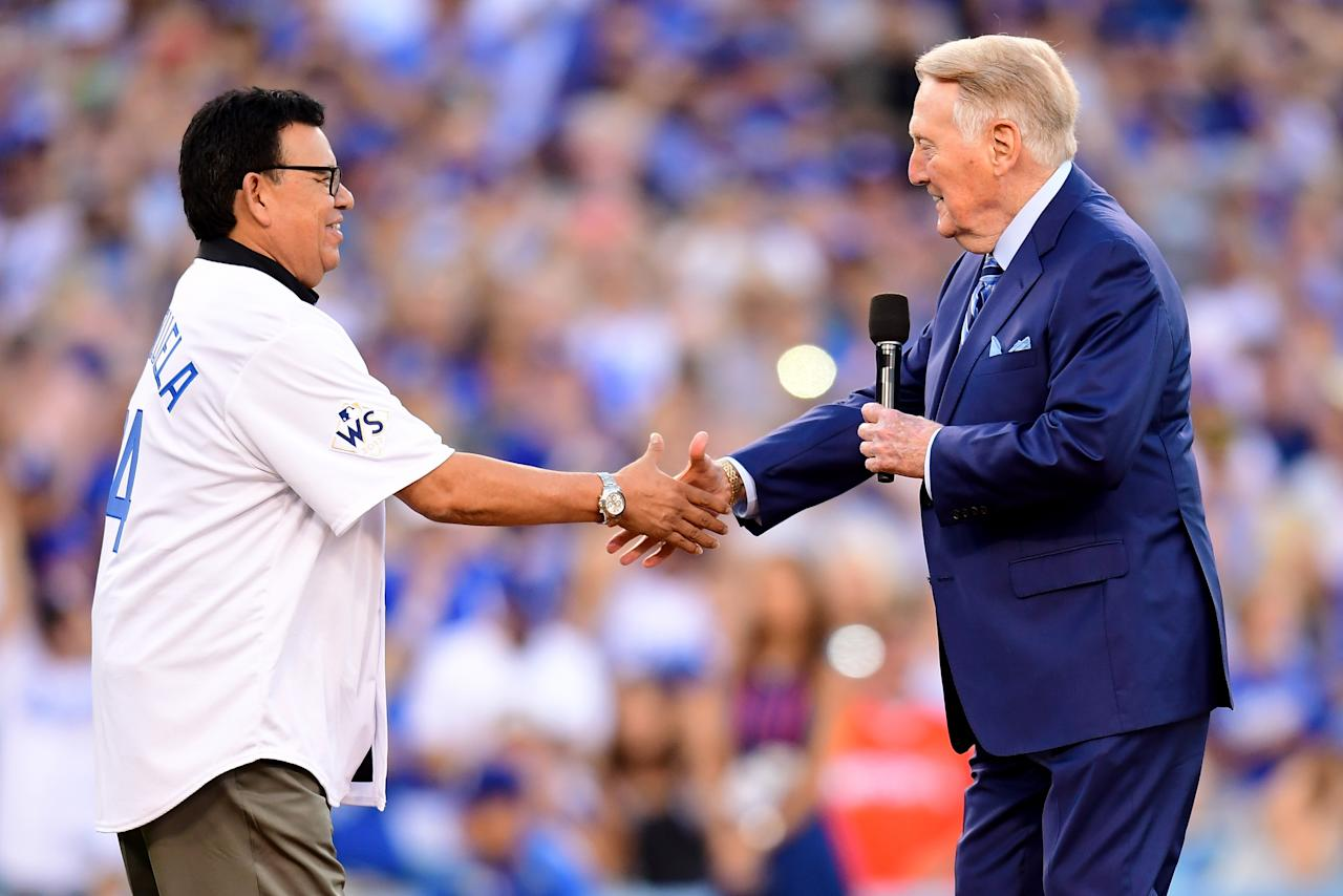 <p>Former Los Angeles Dodgers broadcaster Vin Scully shakes hands with former Los Angeles Dodgers player Fernando Valenzuela before game two of the 2017 World Series between the Houston Astros and the Los Angeles Dodgers at Dodger Stadium on October 25, 2017 in Los Angeles, California. (Photo by Harry How/Getty Images) </p>
