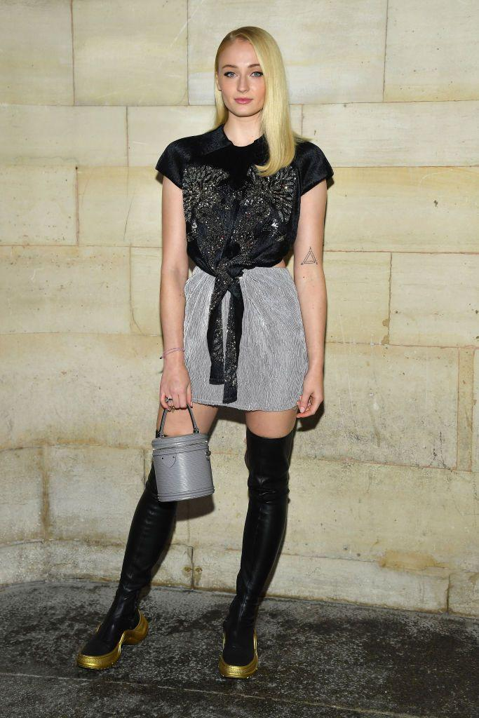 <p>To sit front row at the Louis Vuitton show in Paris, Turner – of course – wore the brand's designs opting for a T-shirt, mini skirt and thigh-high boots by Nicolas Ghesquière.</p>