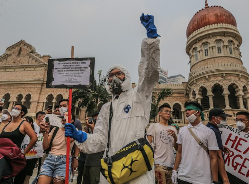 Protesters march and hold placards as they attend the Global Climate Strike in Kuala Lumpur, September 21, 2019. — Picture by Firdaus Latif