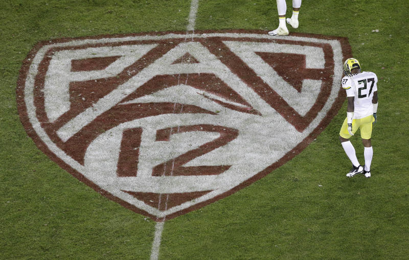 Oregon defensive back Terrance Mitchell (27) walks next to a Pac-12 logo on the field at Stanford Stadium during an NCAA college football game against Stanford in Stanford, Calif., Thursday, Nov. 7, 2013. (AP file photo)