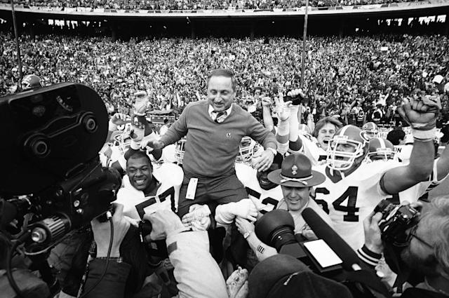 FILE - In this Jan. 2, 1984, file photo, Georgia coach Vince Dooley is carried off the field after Georgia beat Texas 10-9 in the Cotton Bowl in Dallas. Georgia is planning to honor Hall of Fame former coach Vince Dooley by naming the field at Sanford Stadium in his honor. A ceremony has been planned for Georgias 2019 opening game on Sept. 7 against Murray State to dedicate Dooley Field at Sanford Stadium. (AP Photo/Paul Moseley, File)