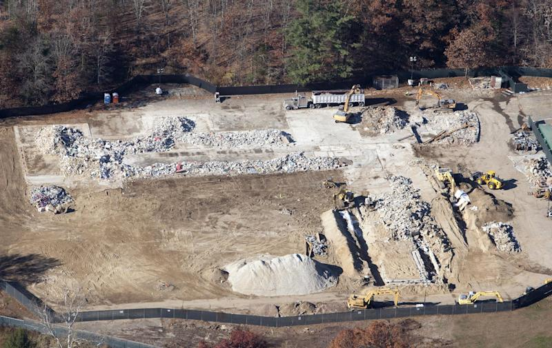 An aerial photo showing demolition work near completion at Sandy Hook Elementary School in Newtown, Connecticut November 13, 2013, the site where a gunman killed 20 children and six adults before taking his own life last December. REUTERS/Michelle McLoughlin (UNITED STATES - Tags: EDUCATION CRIME LAW)
