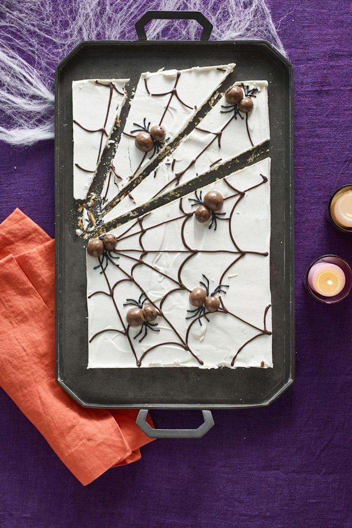 """<p>Not even arachnophobes can resist the itsy-bitsy malt-ball creatures topping this delicious white chocolate-covered pretzel web.</p><p><strong><em><a href=""""https://www.womansday.com/food-recipes/food-drinks/recipes/a60166/candy-cobwebs-recipe/"""" rel=""""nofollow noopener"""" target=""""_blank"""" data-ylk=""""slk:Get the Candy Cobwebs recipe."""" class=""""link rapid-noclick-resp"""">Get the Candy Cobwebs recipe. </a></em></strong> </p>"""