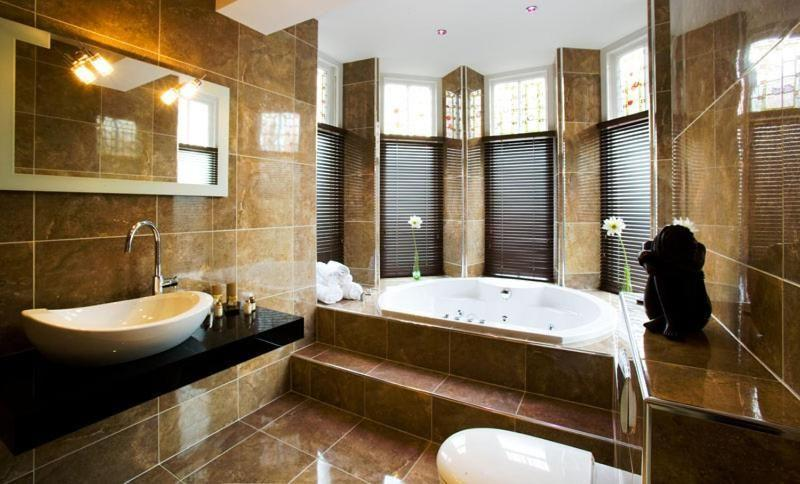 """<p>Tucked away in Windermere town, this Victorian villa hides luxe bedrooms and some seriously stylish hot tub suites, yet never loses its warm and friendly touch. Run by the Mumford family, the adults-only <a href=""""https://www.booking.com/hotel/gb/applegarth-jr-s-restaurant.en-gb.html?aid=2070929&label=luxury-lake-district-hotels"""" rel=""""nofollow noopener"""" target=""""_blank"""" data-ylk=""""slk:Applegarth Villa"""" class=""""link rapid-noclick-resp"""">Applegarth Villa</a> is a place whereyou can hole up for the weekend undisturbed, or tick off the Lake District sites and be welcomed back, muddy boots and all, with a warming cuppa or cocktail. </p><p>It's a cliché, but no two rooms are the same - expect bold wallpapers, quality fabrics and ultra-modern bathrooms. You'll appreciate the variety here; from the smart cocktail bar, like a modern gentlemen's club, to the light-filled conservatory restaurant and the richness of the entrance hall with its oak panelling and stained-glass window. </p><p><a href=""""https://www.redescapes.com/offers/lake-district-windermere-applegarth-villa"""" rel=""""nofollow noopener"""" target=""""_blank"""" data-ylk=""""slk:Read our review of Applegarth Villa"""" class=""""link rapid-noclick-resp"""">Read our review of Applegarth Villa</a></p><p><a class=""""link rapid-noclick-resp"""" href=""""https://www.booking.com/hotel/gb/applegarth-jr-s-restaurant.en-gb.html?aid=2070929&label=luxury-lake-district-hotels"""" rel=""""nofollow noopener"""" target=""""_blank"""" data-ylk=""""slk:CHECK AVAILABILITY"""">CHECK AVAILABILITY</a> </p>"""