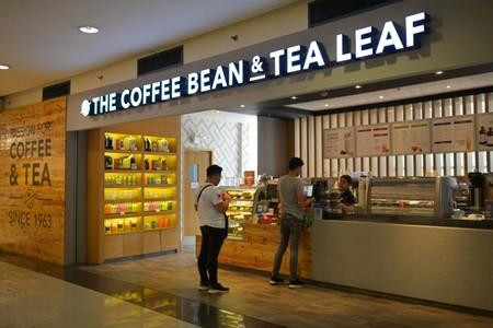 Customers line up at a branch of The Coffee Bean & Tea Leaf in Manila