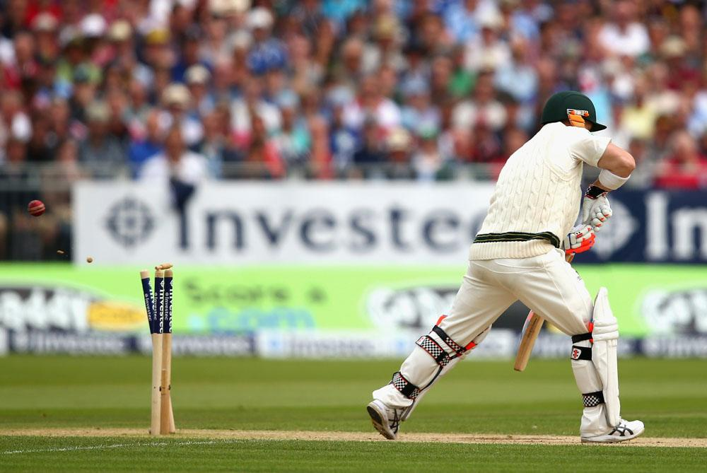CHESTER-LE-STREET, ENGLAND - AUGUST 10:  David Warner of Australia  is bowled by Stuart Broad of England during day two of 4th Investec Ashes Test match between England and Australia at Emirates Durham ICG on August 10, 2013 in Chester-le-Street, England.  (Photo by Ryan Pierse/Getty Images)