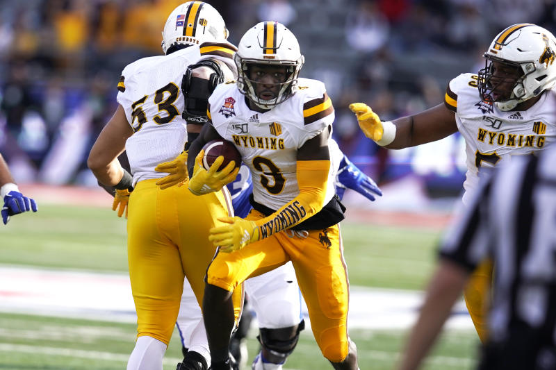 Wyoming safety Alijah Halliburton (3) runs with the football after intercepting a pass during the first half of the Arizona Bowl college football game against Georgia State, Tuesday, Dec. 31, 2019, in Tucson, Ariz. (AP Photo/Rick Scuteri)
