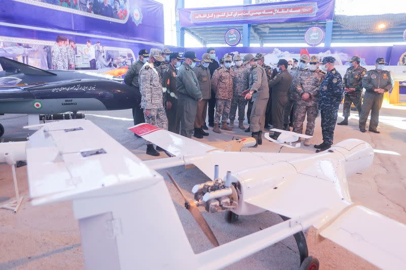Iranian Armed Forces Chief of Staff Major General Mohammad Bagheri and other top commanders visit Iranian-made military drones, unveiled in an exhibition in Semnan