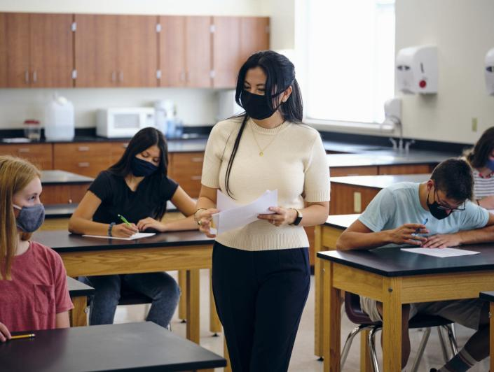 """<span class=""""caption"""">Identity and race play significant factors in the first-year experiences of Latina teachers in the U.S.</span> <span class=""""attribution""""><a class=""""link rapid-noclick-resp"""" href=""""https://www.gettyimages.com/detail/photo/high-school-teacher-and-students-in-classroom-royalty-free-image/1264702811?adppopup=true"""" rel=""""nofollow noopener"""" target=""""_blank"""" data-ylk=""""slk:RichLegg/E+ via Getty Images"""">RichLegg/E+ via Getty Images</a></span>"""