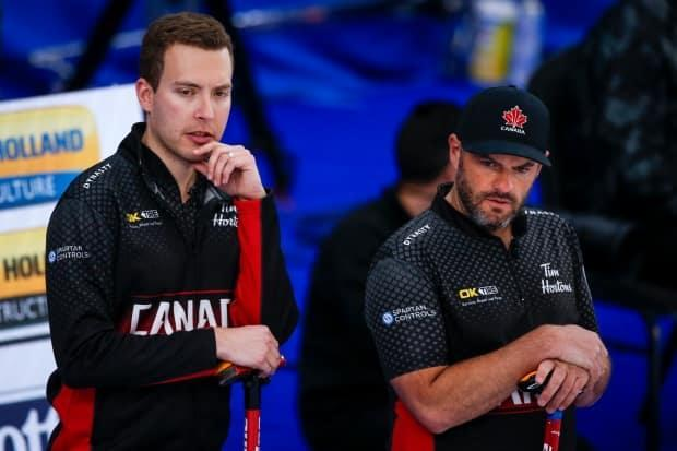 Canada skip Brendan Bottcher, left, third Darren Moulding, right, and the rest of the team face an uphill battle at the men's world curling championship.  (Jeff McIntosh/Canadian Press - image credit)