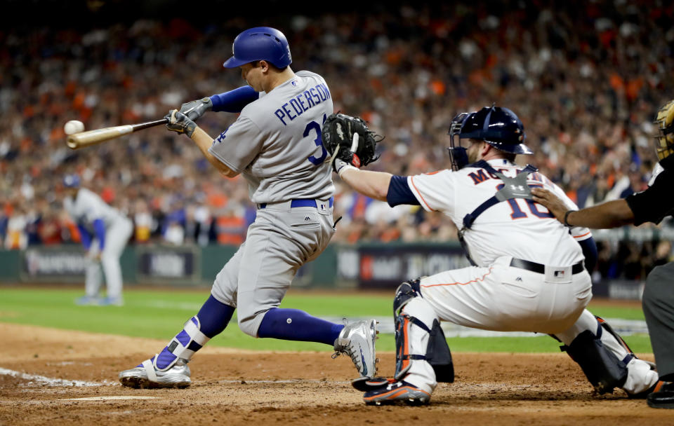 Joc Pederson hits a three-run home run against the Houston Astros during the ninth inning of Game 4 of the World Series. (AP)
