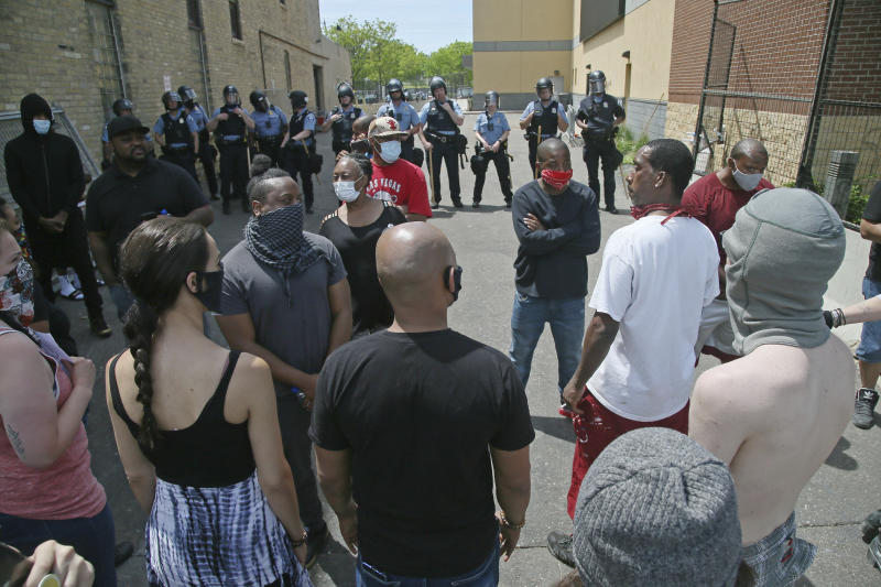 Protesters face off with police at the Minneapolis Police Third Precinctt, Thursday, May 28, 2020, after a night of rioting as protests continue over the arrest of George Floyd who died in police custody Monday night in Minneapolis after video shared online by a bystander showed a white officer kneeling on his neck during his arrest as he pleaded that he couldn't breathe. (AP Photo/Jim Mone)