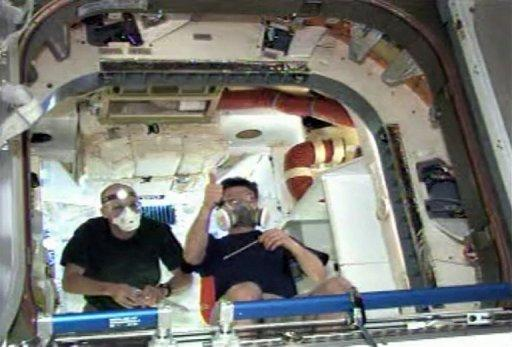 This frame grab from a NASA video shows NASA astronaut Don Pettit (L) and Russian cosmonaut and ISS Commander Oleg Kononenko enter the Dragon capsule on May 26. The ISS crew is to unhook the capsule from space station power sources on Thursday and complete final preparations