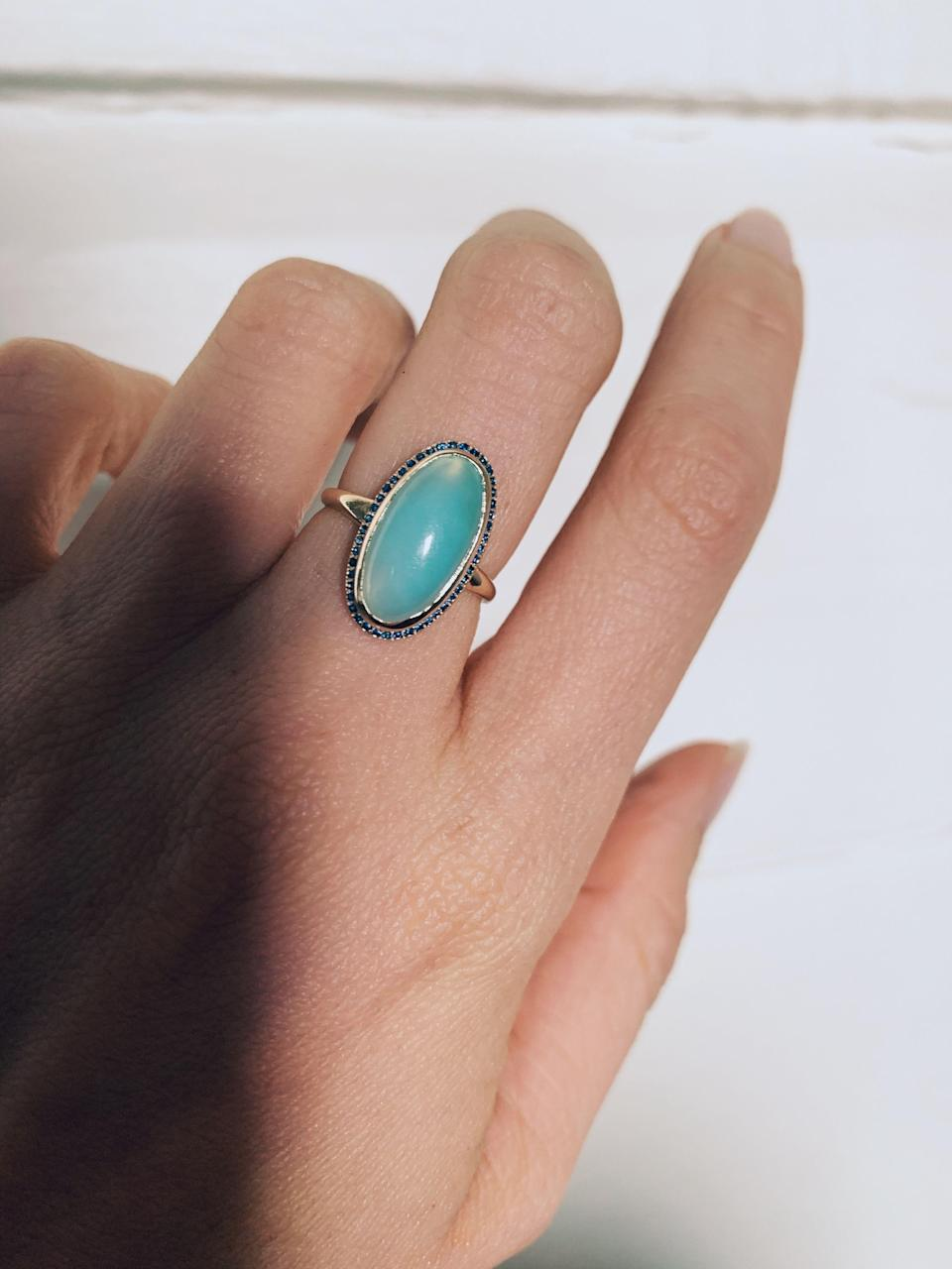 "<p><strong>Olivia Kane</strong></p><p><strong>$2350.00</strong></p><p><a href=""https://www.oliviakane.co/rings/peruvian-opal-ellipse-ring"" rel=""nofollow noopener"" target=""_blank"" data-ylk=""slk:Shop Now"" class=""link rapid-noclick-resp"">Shop Now</a></p><p>Nothing says luxury like a one-of-a-kind ring featuring a 9.6-carat Peruvian blue opal and 45 blue sapphires.</p>"