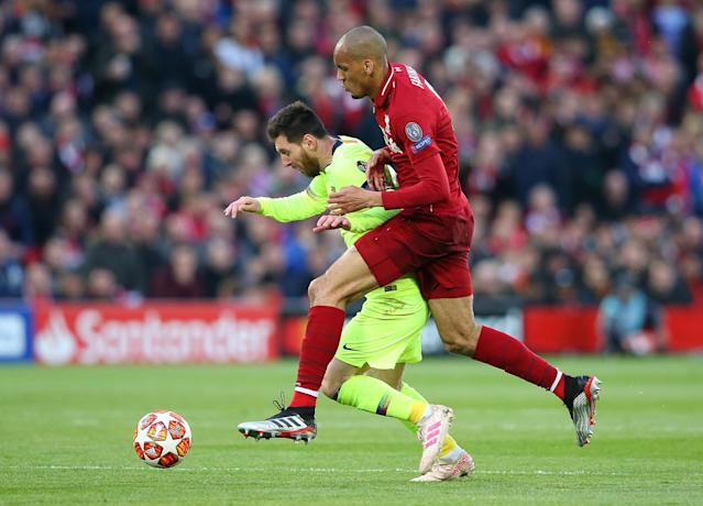 Lionel Messi of Barcelona beats Fabinho of Liverpool during the UEFA Champions League Semi Final second leg match between Liverpool and Barcelona at Anfield on May 07, 2019 in Liverpool, England. (Photo by Alex Livesey - Danehouse/Getty Images)