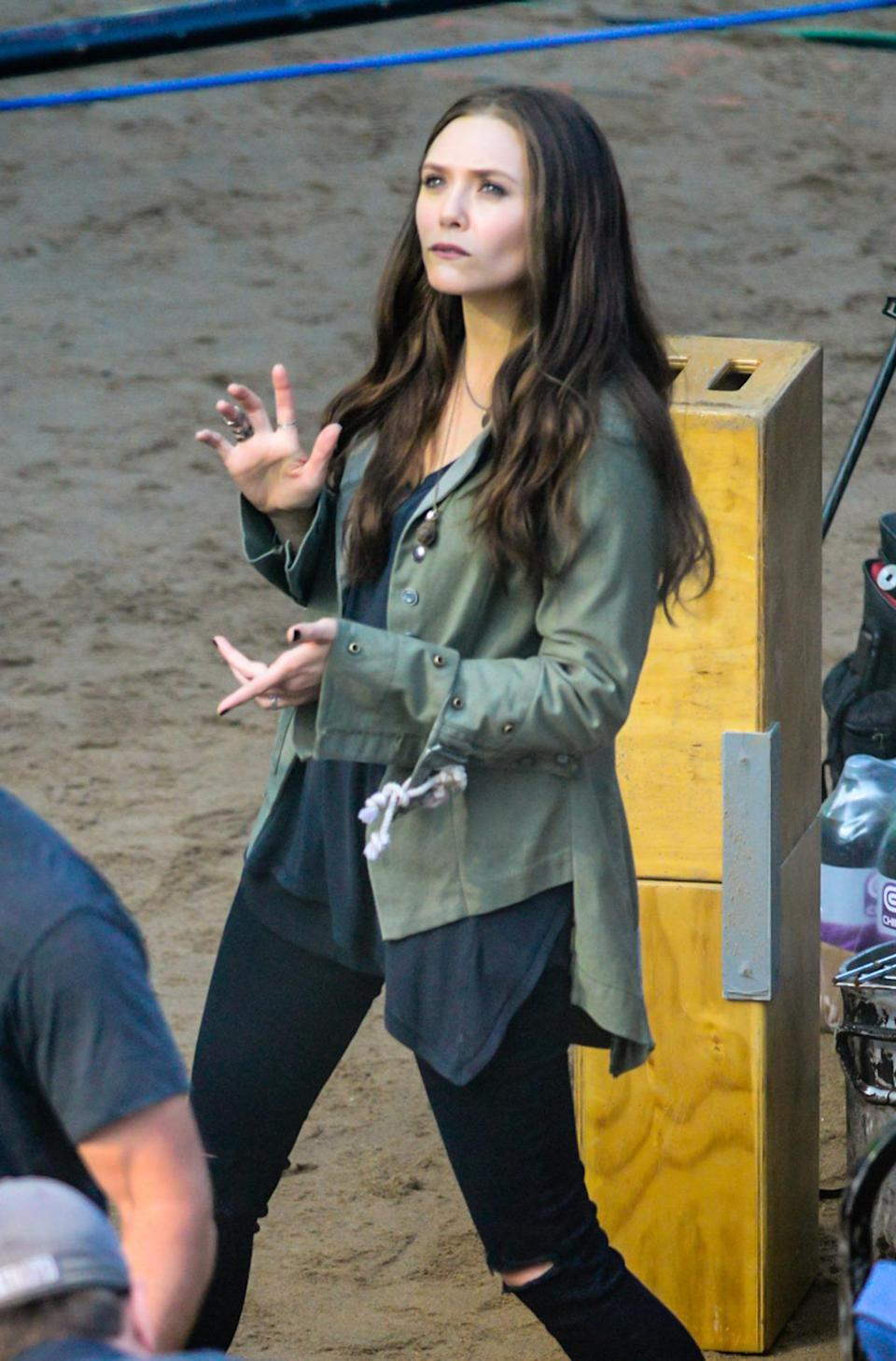 First sighting of Elizabeth Olsen doing some Scarlet Witch magic on the 'Civil War' set on May 20.