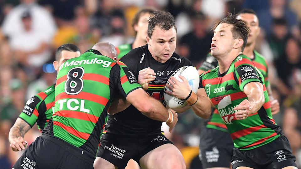Dylan Edwards is seen here running the ball for the Panthers in the grand final win over the Rabbitohs.
