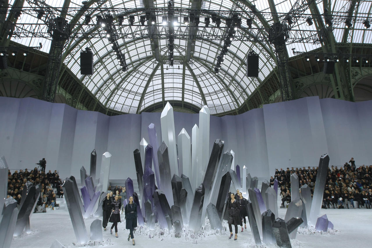 Models wear creations by German Fashion designer Karl Lagerfeld as part of the Chanel presentation for Women's Fall-Winter, ready-to-wear 2013 fashion collection, during Paris Fashion week, Tuesday, March 6, 2012. (AP Photo/Jacques Brinon)