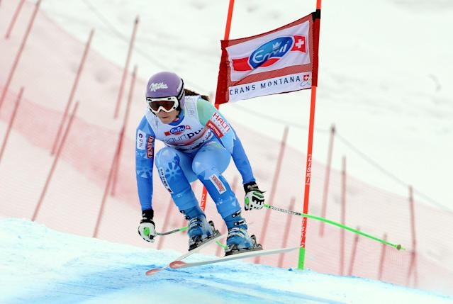 Slovenia's Tina Maze clears a gate on her way to take third place in an alpine ski, World Cup women's downhill, in Crans Montana, Switzerland, Sunday, March 2, 2014. (AP Photo/Pier Marco Tacca)