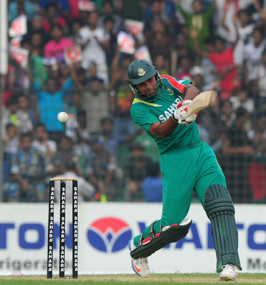 Bangladesh batsman Ziaur Rahman plays a shot during the third One-Day International (ODI) cricket match between Bangladesh and New Zealand at Khan Jahan Ali Stadium in Fatullah, on the outskirts of Dhaka on November 3, 2013.   AFP PHOTO/ Munir uz ZAMAN        (Photo credit should read MUNIR UZ ZAMAN/AFP/Getty Images)