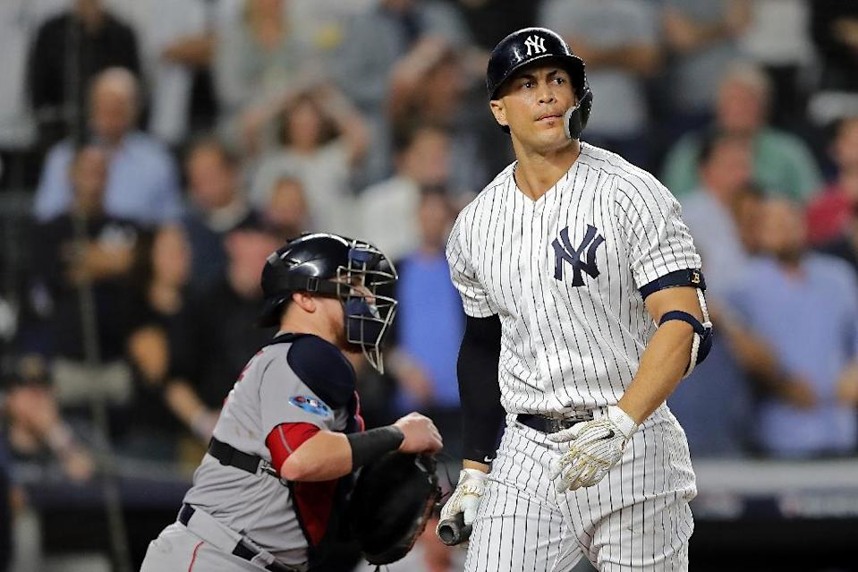 Giancarlo Stanton of the New York Yankees strikes out in the ninth inning against the Boston Red Sox (AFP Photo/ELSA)