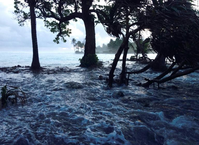 The UN issues an urgent call to arms to the world to fight climate change such as rising sea levels which threaten millions living in low-lying areas, such as here in the Marshall Islands