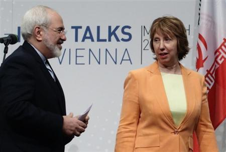 Iranian Foreign Minister Mohammad Zarif and European Union foreign policy chief Ashton leave a news conference in Vienna
