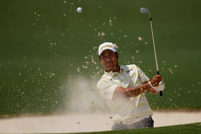 Hideki Matsuyama hits out of a bunker during the final round of the Masters