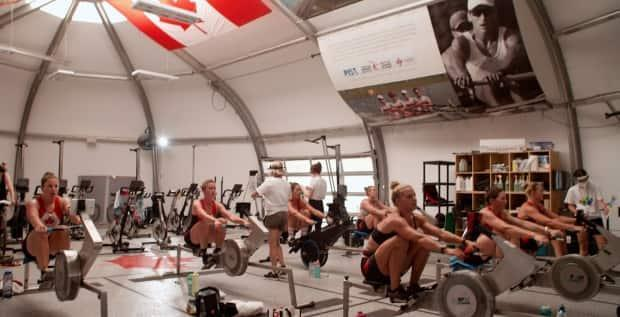 In order to prepare for the extreme heat expected in Tokyo, the Canadian women's eight rowing team has been training in an 'erg dome' in Victoria, B.C., that's heated to 35 C. (Dan Batchelor - image credit)