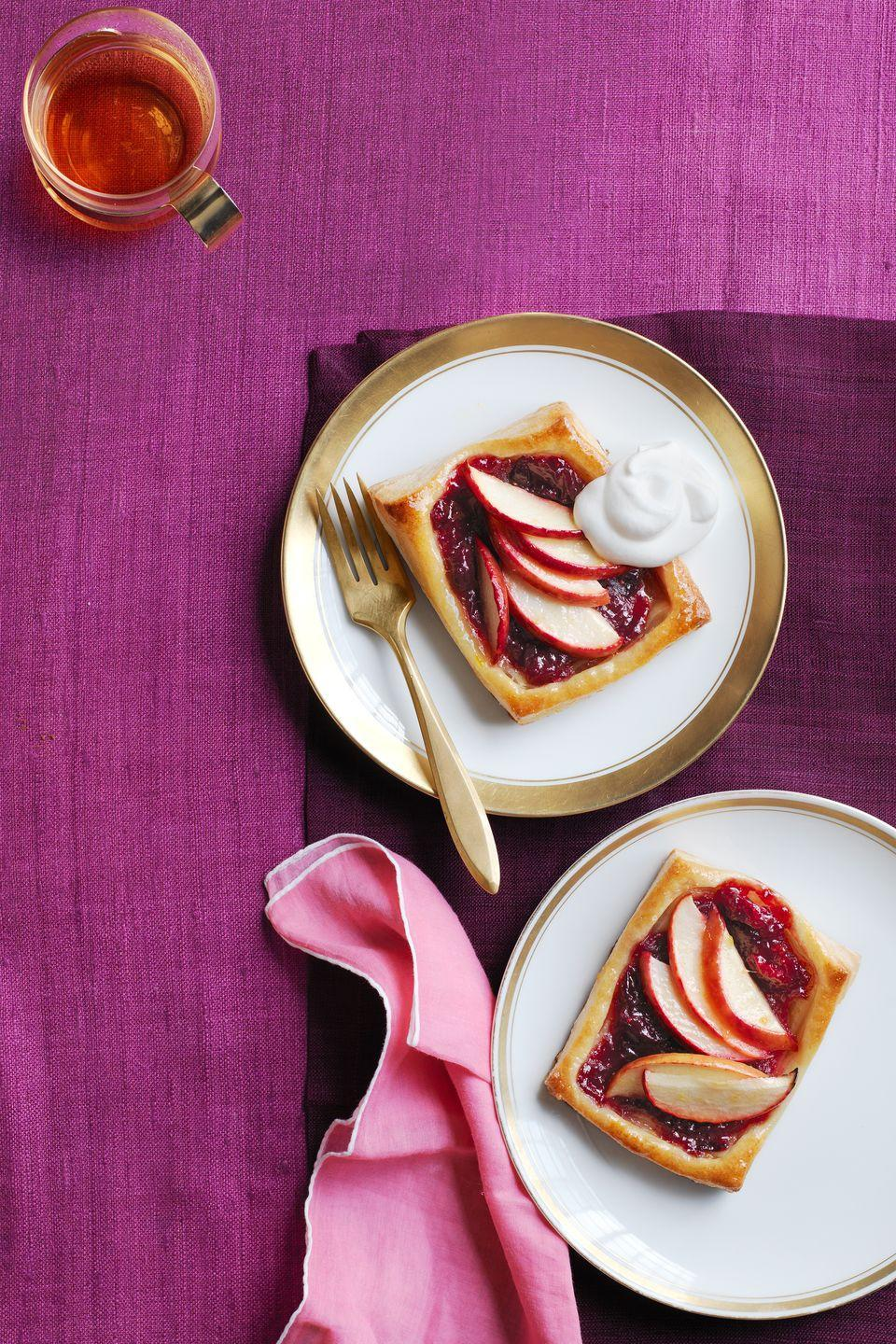 "<p>All of the best fall fruit gets wrapped up in one easy-to-eat tart for this Thanksgiving dessert.</p><p><strong><em><a href=""https://www.womansday.com/food-recipes/food-drinks/recipes/a52043/cranberry-apple-tarts/"" rel=""nofollow noopener"" target=""_blank"" data-ylk=""slk:Get the Cranberry Apple Tarts recipe."" class=""link rapid-noclick-resp"">Get the Cranberry Apple Tarts recipe. </a></em></strong></p>"