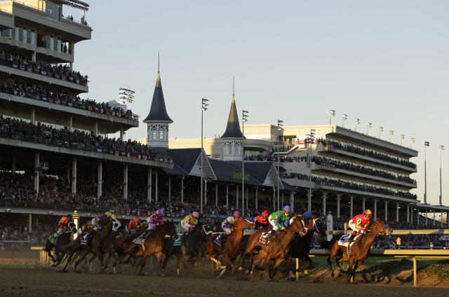 FILE - In this Nov. 4, 2011, file photo, horses make their way around turn one during the Juvenile Fillies race at the Breeders' Cup horse races at Churchill Downs in Louisville, Ky. There's little argument this year's Breeders' Cup Classic lost a little luster when an ankle issue forced Triple Crown champion Justify into retirement and out of a marquee race that could have raised the profile for both. While the 35th Classic at Churchill Downs features a competitive 14-horse field, the entrants are certainly less familiar than the colt many hoped would at least pursue a grand slam after winning the Kentucky Derby, Preakness and Belmont Stakes this spring. (AP Photo/Matt Slocum, File)