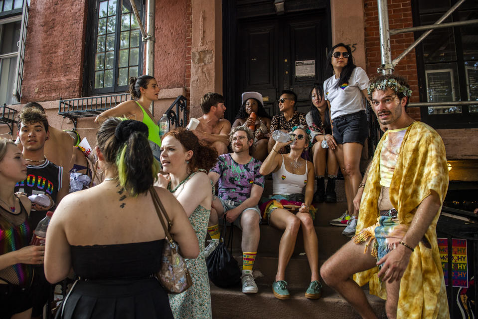 People gather near the Stonewall Inn during the Queer Liberation March in the West Village on Sunday, June 27, 2021, in New York. (AP Photo/Brittainy Newman)