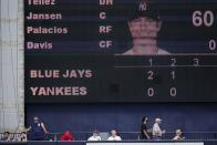 Fans watch the Toronto Blue Jays play the New York Yankees before the third inning of a spring baseball game Sunday, Feb. 28, 2021, in Tampa, Fla. (AP Photo/Frank Franklin II)