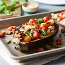 <p>We took all the elements of a classic caprese--tomatoes, fresh mozzarella, basil and balsamic vinegar--and stuffed them inside a fresh-baked eggplant. The result is a perfect vegetarian, late-summer dinner everyone will enjoy.</p>