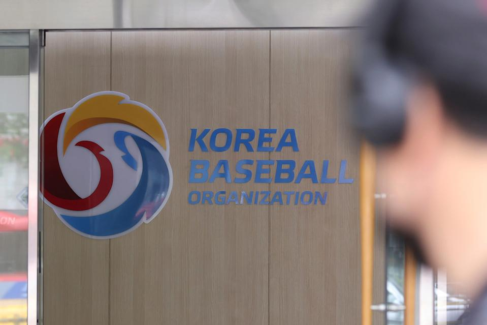 A logo of the Korea Baseball Organization is posted on a wall in Seoul, South Korea, Sunday, July 11, 2021. South Korea's professional baseball league has suspended its regular season as the largely unvaccinated country grapples with the worst wave of the coronavirus since the start of the pandemic.