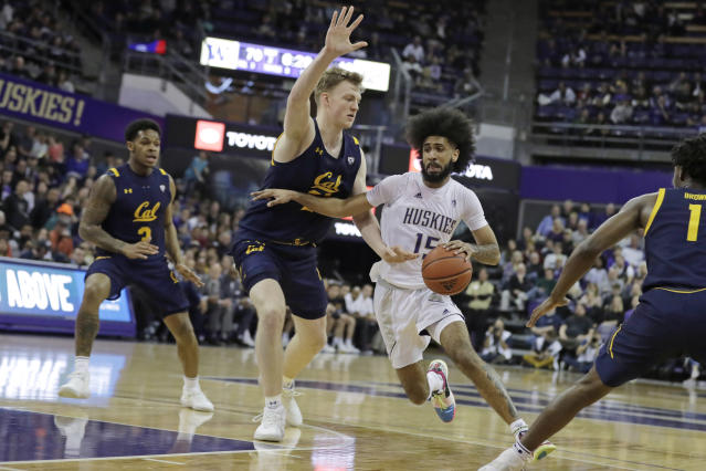 Washington guard Marcus Tsohonis (15) drives past California forward Lars Thiemann, second from left, during the second half of an NCAA college basketball game Saturday, Feb. 22, 2020, in Seattle. Washington won 87-52. (AP Photo/Ted S. Warren)
