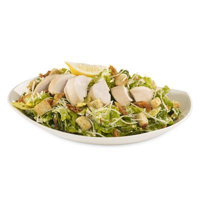 """<p>Roasted chicken breast, romaine lettuce, parmesan, browned croutons, and crispy chicken shavings — this salad contains 54 grams of fat (9 grams saturated) — <strong>and this is without the dressing. </strong>Watch out for the sugar content found in their Bangkok salads; moderate to regular servings will pack in between 24 grams to 45 grams per serving of sugar.<br><br><strong>Salad serving size: 485 g </strong><br> — Calories: 830<br> — Fat: 54 g (Saturated Fat 9 g)<br> — Carbohydrates: 21 g <br> — Sodium: 1,040 mg <br> — Sugar: 3 g <br> — Protein: 64 g<br> — Source/photo: <a href=""""http://www.st-hubert.com/pdf/Nutritives%20Values.pdf?v=35"""" rel=""""nofollow noopener"""" target=""""_blank"""" data-ylk=""""slk:St-Hubert"""" class=""""link rapid-noclick-resp"""">St-Hubert<br></a><br><strong>TRY THIS INSTEAD:</strong> St-Hubert garden salad with chicken (Fat: 14 g/Sat. Fat 7 g/Sodium: 610 mg) </p>"""